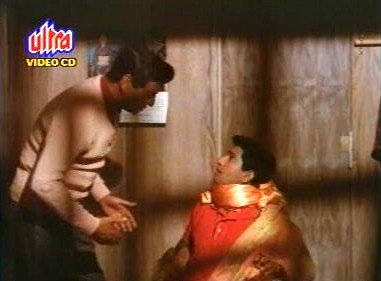 Pran finds Mohan wrapped in Asha's sari