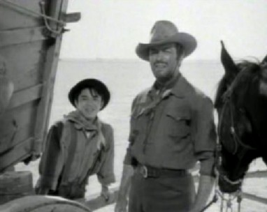 Robert Taylor with Henry Nakamura in Westward the Women