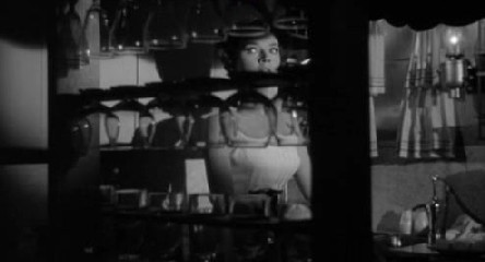 And another: Polly Bergen and a rack of glasses