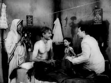 Ranu looks on while Nirmal attends to patients
