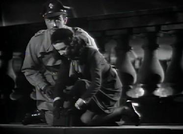 A younger Cronin meets Myra on Waterloo Bridge during a WWI air raid