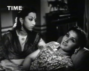 Lata and Basanti discuss a mysterious love in Lata's life