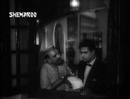 Kailash notices Badri Prasad from the window of Dhani Ram's house
