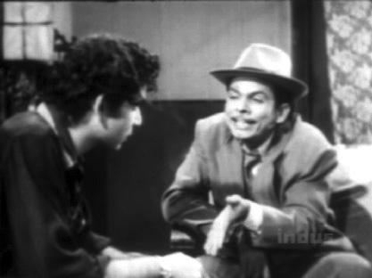 Johnny accepts a bribe, seemingly