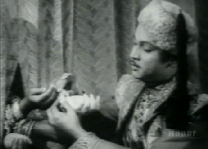Shirazi puts the imperial bangle on Ruhi's wrist