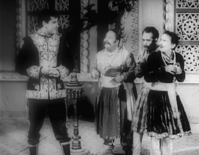 Vijay Pratap orders his courtiers to find a sadhu to cure Radha of her obsession for Mohan