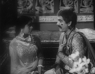 Radha discovers Mohan behind yet another disguise