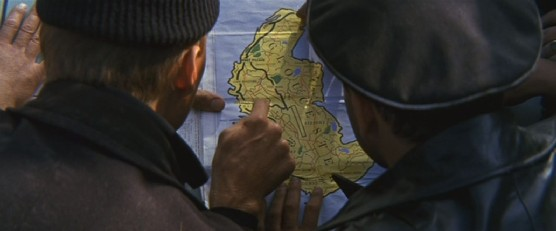 The Russians examine a map they find...