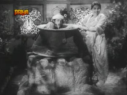 Bindiya helps Gul Mirza into a cauldron