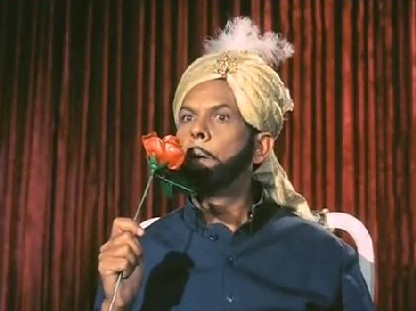Johnny Walker as Isa Bhai Suratwala in Anand