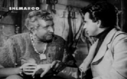 Paan Raja attends to Anand's wound