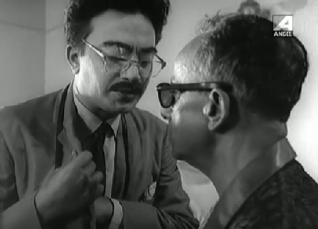 Byomkesh disguised as the Japanese, Okakura