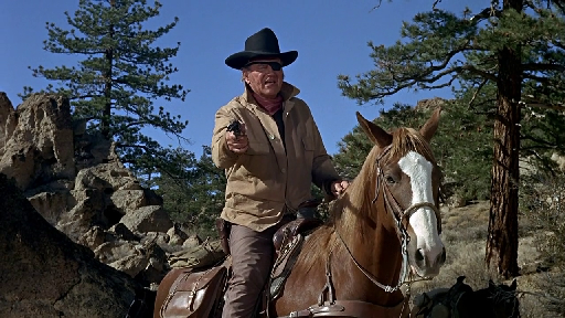 John Wayne as Rooster Cogburn in True Grit