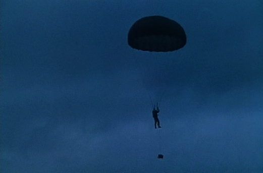 Eddie is parachuted into England to blow up Vickers