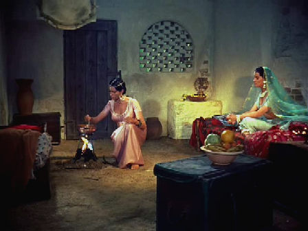 Seetha and Baharani exult over the escort they'll be getting to Eschnapur