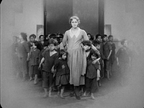 Maria brings some workers' children to the Eternal Gardens