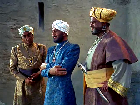Padhu (in the boat-like turban) and Ramigani (in blue) plot