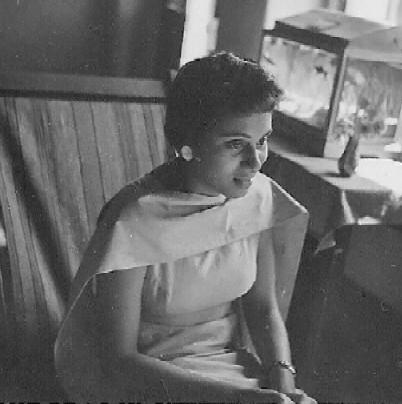 ... and Mama, near a window