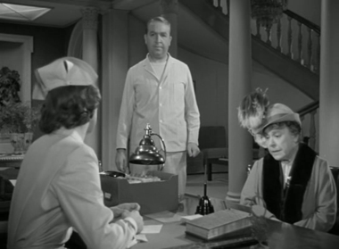 Wilson gets orders to take Elwood upstairs to a room to begin treatment