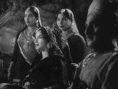 Radha arrives at the performance with a cop