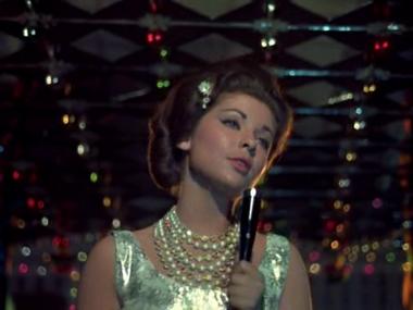 Erica Lal in Waqt, as the crooner in Aage bhi jaane na tu