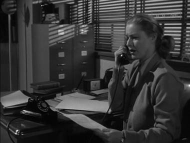Elizabeth at work - and making mistakes because of her forgetfulness