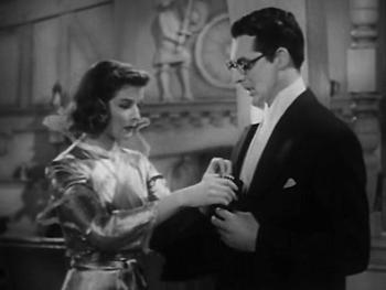 Susan hands David her purse