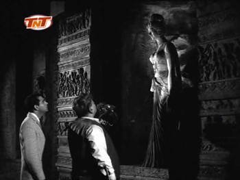 Professor Sahib and Rakesh examine an old statue
