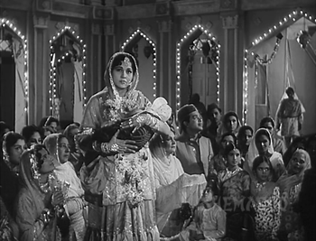 ...while the begum presides at the celebrations