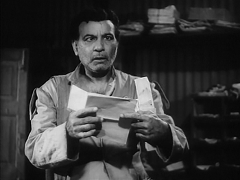 Haradhan has a look at the letter