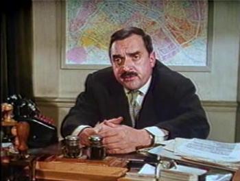 Inspector Grandpierre talks to Reggie