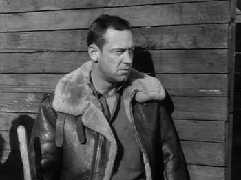 William Holden as JJ Sefton in Stalag 17