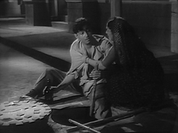 Keshav's mother comes to take him to his father's deathbed