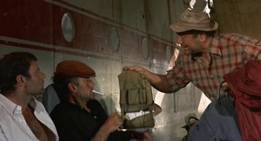 Cobb distributes his belongings in preparation to 'travel light'