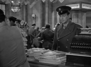 Zac stops to buy a magazine