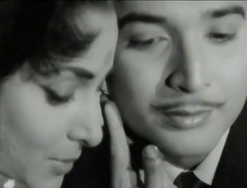 Waheeda Rehman and Biswajeet as Raj and Amit