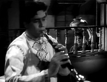Gopi, enchanted by Kishan's shehnai
