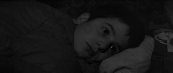 Antoine lies in bed and listens