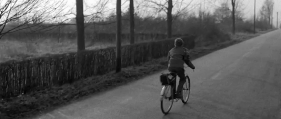Rene rides away on his cycle