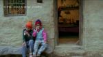 Makar and Kamru outside their home
