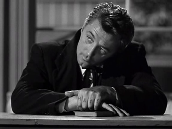 Robert Mitchum as Harry Powell in The Night of the Hunter