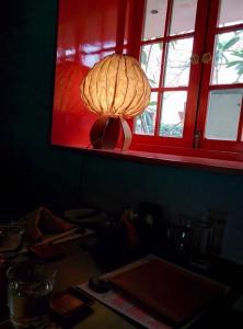 A pretty paper lantern on a windowsill.