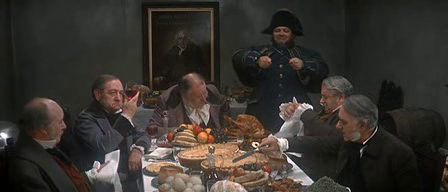 The governors at the workhouse sit down to a meal...