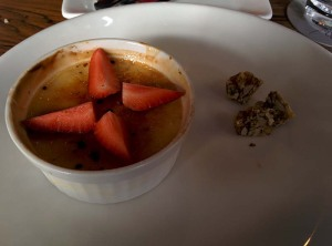 Classic vanilla creme brulee, served with praline and a quartered strawberry.