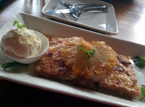 Coconut French toast, served with caramelised pineapple and vanilla ice cream.