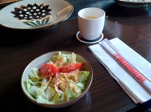 Two of the most disappointing things we consumed: a tasteless green tea and a frightful salad.