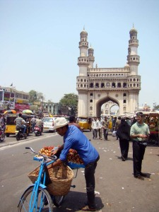 A seller of pomegranates attends to his wares in front of the Charminar.