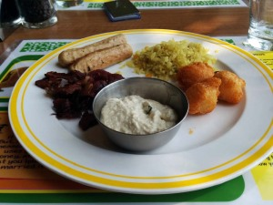Breakfast at Citrus: poha, aloo bondas, coconut chutney - and bacon and sausages!