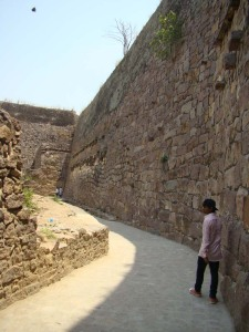 Salim guides us through Golconda, showing us water pipes slung along this high wall.