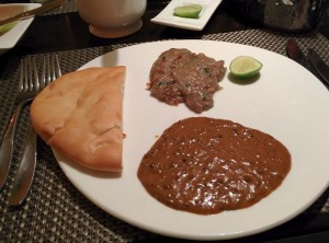 Dinner at Kebab Theater: taaftaan, haleem, and daal-e-balai.